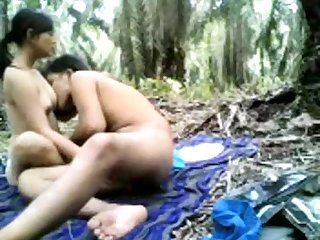 Indian Desi teen girl with boyfriend in the open forest