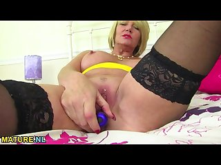 Big titted blonde mature toying her pussy