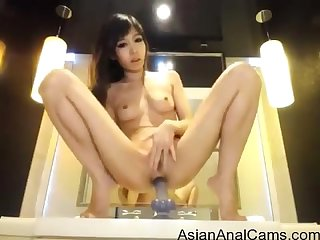 Sexy asian Camgirl rides anal dildo and loves it