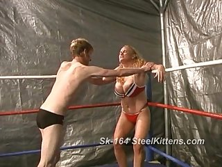 Sandy v chuck mixed mature wrestling in ring