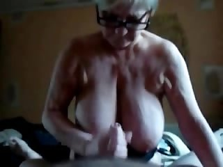 Massive titted granny gives bj tj hj to young boy