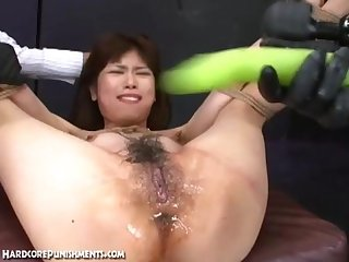Japanese women gets a huge dildo inserted into her lubed pussy