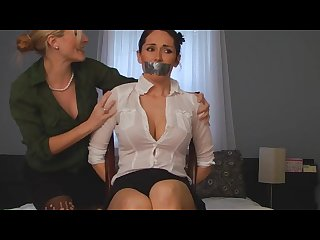 Sexy submissive chair tied and tape gagged