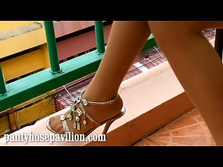 Indonesian model does a sexy non nude pantyhose leg tease
