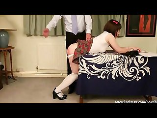 Cute crossdresser schoolgirl gets hard spanking over the desk for cheating