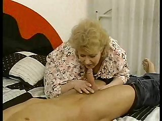 Mature euro gal fucks a muscle hunk