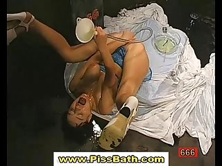 Piss drinking babe gets pissed on in reality watersports sex