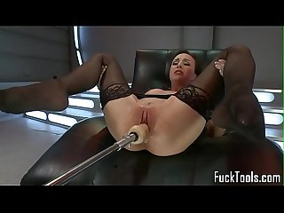 Busty MILF squirts and orgasms over machine