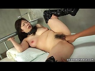 Collared asian endures rough fingering and a nipple torture