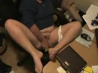 My mum masturbating at her desk caught by hidden cam
