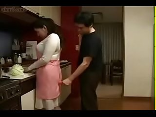 Japanese milf and young boy in kitchen fun