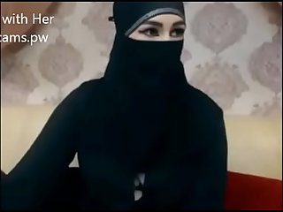 Indian muslim girl in hijab live chatting on webcam
