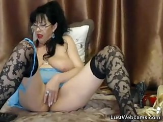 Busty mature masturbates with dildo on cam