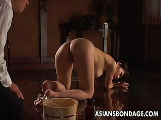 Nasty asian tied up babe gets to be pussy treated