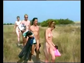 Busty girl blows three cocks at Cap d agde beach