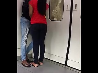 Indian students getting cozy in delhi metro kissing