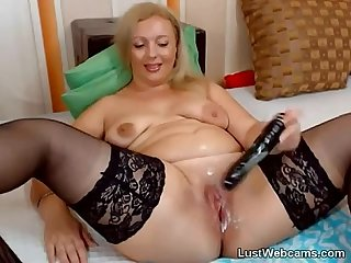 Blonde milf masturbates with dildo on webcam
