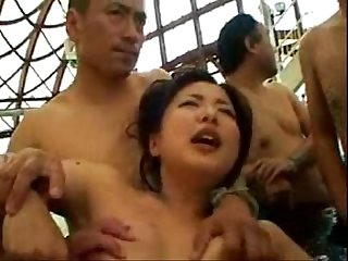 The Japanese woman that it is played a toy in a pool