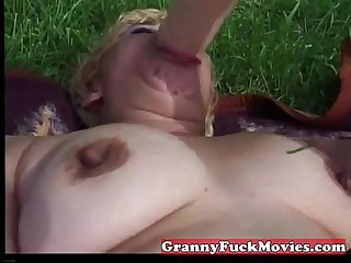 Naughty grandma giving her pussy a fingerfuck