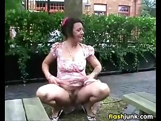 Wild mature woman flashing outdoors