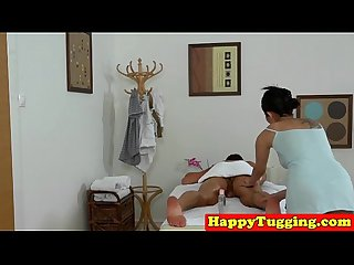 Busty asian masseuse tugs while getting oral