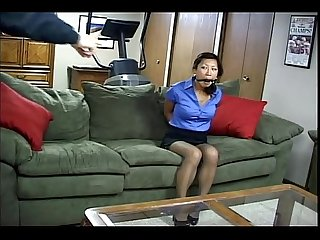 Sexy asian woman is tied up gagged and forced to fuck