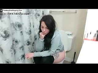 Dark haired babe dropped a big turd in toilet without knowing that her roommate