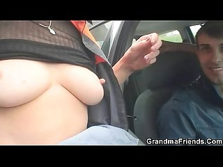 Old bitch swallows two cocks outdoors
