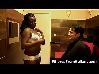 Topless black hooker sucks her lucky clients cock