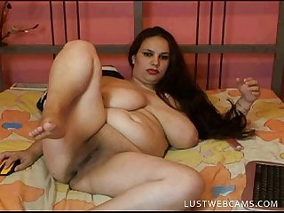Busty plumper masturbates on cam